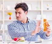 Man having dilemma between healthy food and bread in dieting con poster