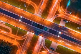 Intersection Of Two Major Highways, Intersection Under A Bridge, Night Aerial Top View Of Street Lig