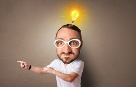 Funny person with big head with new idea concept and lighting bulb