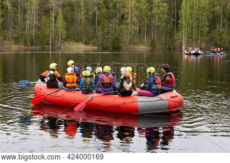 Petrozavodsk, Russia - May 16th, 2021: Group Of Tourists Rafting On The Rubber Boat Down The River I