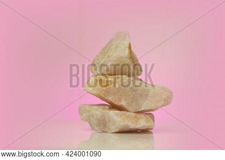 Rose Quartz.crystals Of Rose Quartz On A Pink Background.pyramid Of Pink Stones.