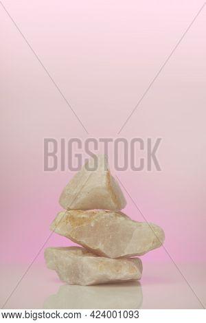 Rose Quartz. Mineral Quartz.crystals Of Rose Quartz On A Pink Background.pyramid Of Pink Stones.