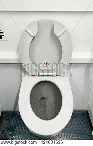 Toilet Seat In Passanger Airplane Lavatory Close Up