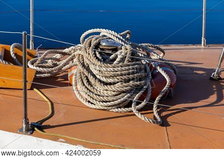 Mooring Rope On The Deck Of A Wooden Yacht