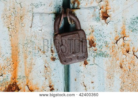 Old Padlock On Rusty Door