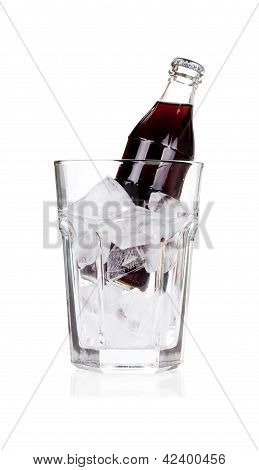 Bottle Of Cold Cola With Ice On White
