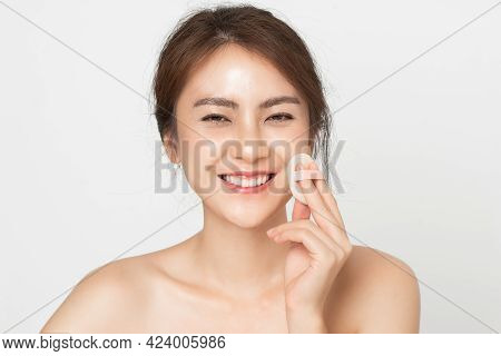 Beauty Makeup. Young Asian Woman Smile Looking Happy Applying Makeup With Puff Makeup On White Backg