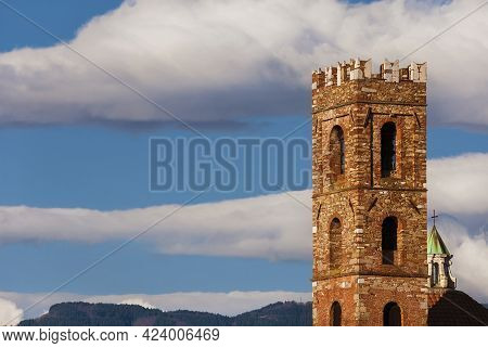 Church Of Ss John And Reparata Ancient Belfry In The Shape Of Medieval Tower Rises In The Sky Among