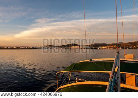 Pink Sunrise Over The Sea And Naoussa Coastal Village Paros Island, Landscape View From Sailing Boat