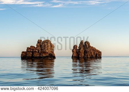 Nes Portes Rocks With A Cross On Top, North Of Paros Island Sticking Out From Perfectly Flat Calm Me