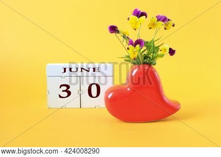 Calendar For June 30 : The Name Of The Month Of June In English, The Number 30 On Cubes, A Vase In T