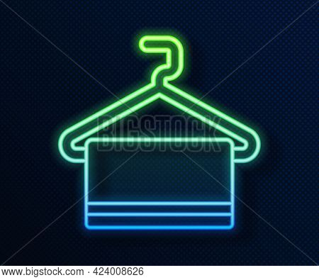 Glowing Neon Line Towel On Hanger Icon Isolated On Blue Background. Bathroom Towel Icon. Vector