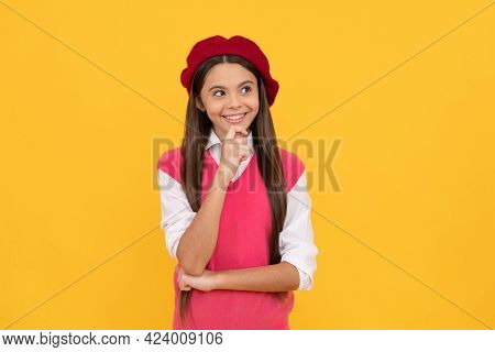 Thoughtful Teen School Girl In French Beret On Yellow Background, Think