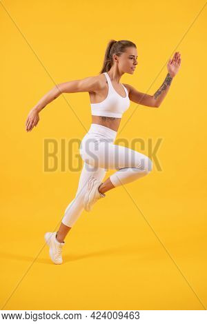 Sprinter. Sport Athlete Run Fast To Win. Healthy Woman Jumping Or Running.