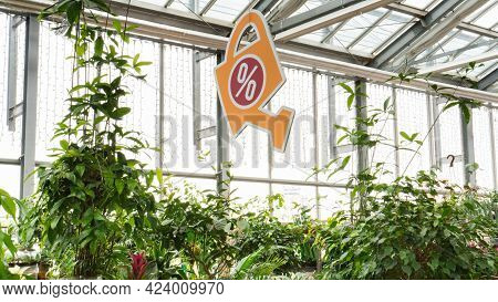 Sale Banner In A Garden Store. Seasonal Sale Of Home Potted And Garden Plants In The Flower Section