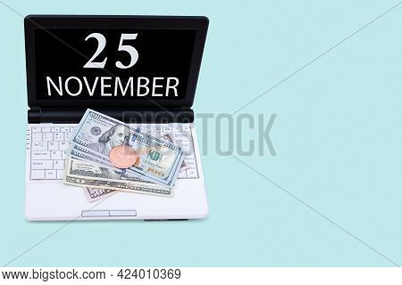 25th Day Of November. Laptop With The Date Of 25 November And Cryptocurrency Bitcoin, Dollars On A B