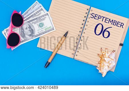 6th Day Of September. Travel Concept Flat Lay - Notepad With The Date Of 6 September Pen, Glasses, D