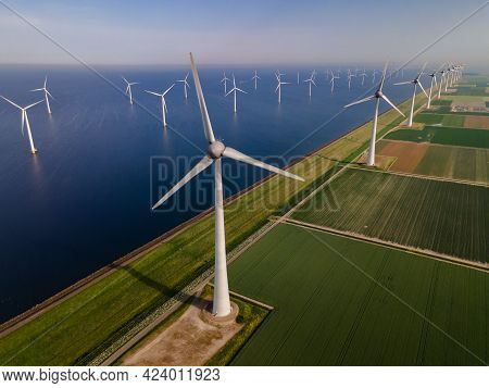 Wind Turbine From An Aerial View, Drone View At Windpark A Windmill Farm In The Lake Ijsselmeer The