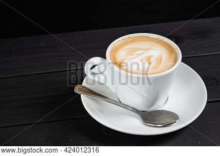cup of cappuccino on the black background