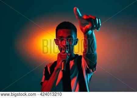 African-american Young Mans Portrait On Red Studio Background In Neon. Concept Of Human Emotions, Fa