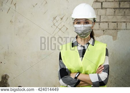 Waist Up Portrait Of Young Woman Wearing Hard Hat