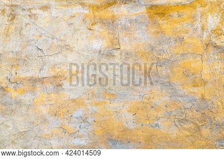 Background With An Old Concrete Wall With An Orange Cracked Paint