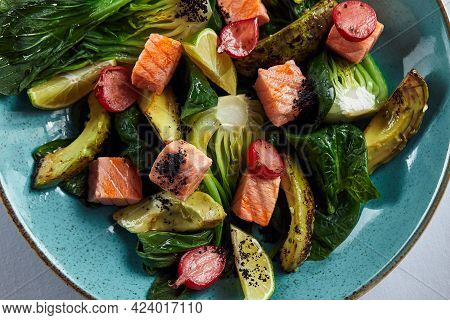 Baked Salmon With Artichokes, Avocado And Cherry, Close-up, Top View. Chefs Signature Salad Of Baked