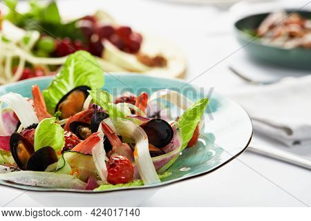 Mussels Vongole In A Plate With Salad, Mussels Cooked In White Wine Sauce, On A Party Table, With Wh