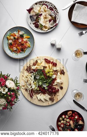 Assorted Food, Banquet Table With Snacks, Italian Appetizers On A White Table, Top View, Assorted Sa