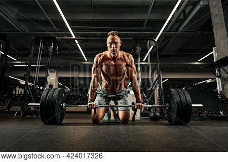 Young Shirtless Man Doing Deadlift Exercise At Gym. Screaming For Motivation