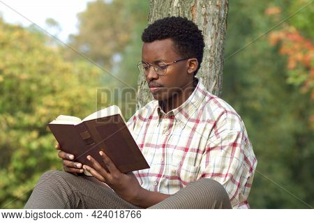 Portrait Of Handsome Intelligent Black African Man, Young Afro American Guy In Glasses And Shirt Is