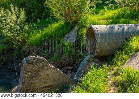 A Sewer Pipe Drains Sewage Into The City River. Environmental Pollution, Rivers.