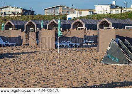 June 10, 2021 Katwijk, Netherlands,  Beach Cabins, Sunshades On Katwijk Strand During The  Sunset