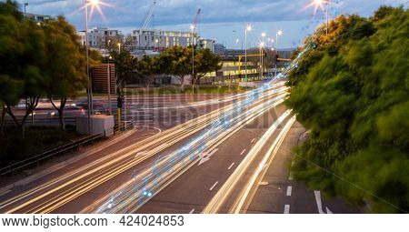 Glowing blue network of connections against view of night city traffic. global networking and connection technology concept