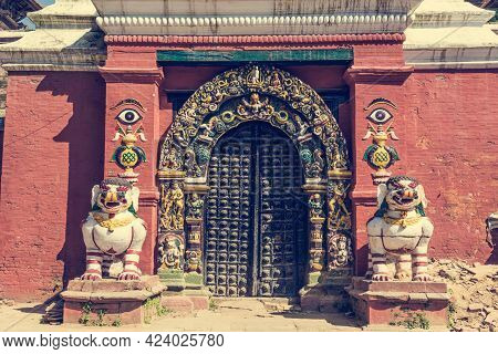 Wooden Temple Gate Guarded By Religious Deities.