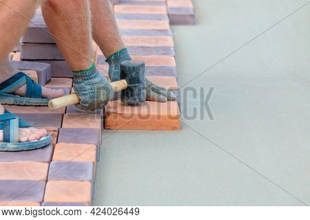 Craftsmen Are Laying Paving Stones On The Streets Of The City. Laying Paving Stones.