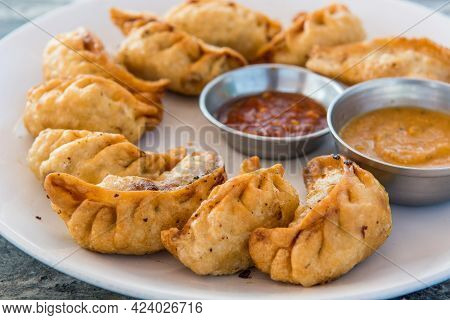 Plate Of Traditional Momos Served With Tasty Dipping.