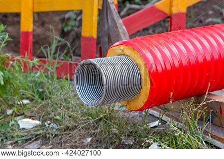 The Red Pipe Is Prepared For The Replacement Of The Water Supply. Replacement Of The City Pipeline.