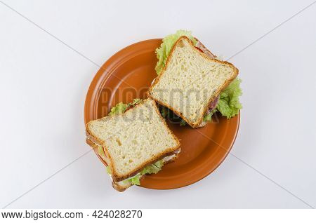 Sandwiches And Brown Clay Plate On White Background. Square Sandwiches With Ham, Tomato, Lettuce, Di