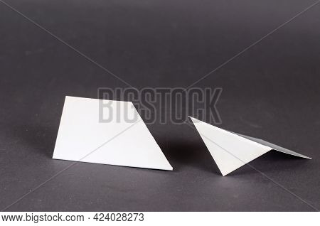 Abstract Geometric Composition Of Various White Shapes On A Gray Background. Two Geometric Shapes Wi