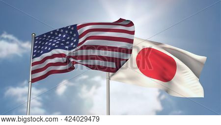 American and japanese flag waving against clouds in blue sky. international relations and affairs concept
