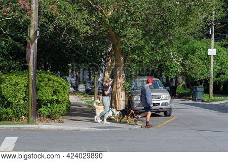New Orleans, La - June 9: Young Couple Walking Their Dogs In Uptown Neighborhood On June 9, 2021 In