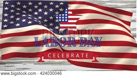 Happy labor day text and waving american flag on wooden background. american labor day template background design concept