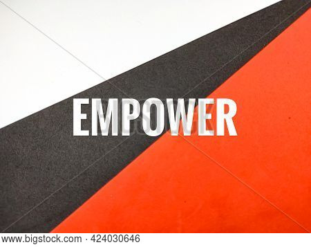 Text Empower On Red,black And White Background.