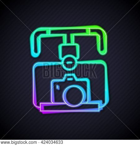 Glowing Neon Line Gimbal Stabilizer With Dslr Camera Icon Isolated On Black Background. Vector