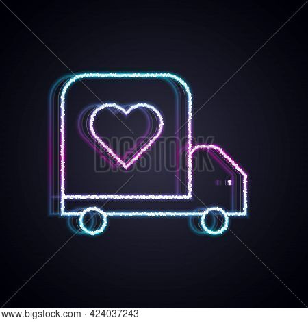Glowing Neon Line Delivery Truck With Heart Icon Isolated On Black Background. Love Delivery Truck.