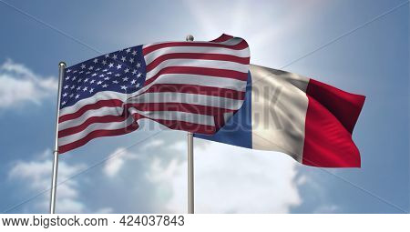 American and french flag waving against clouds in blue sky. international relations and affairs concept