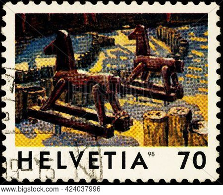 Moscow, Russia - June 14, 2021: Stamp Printed In Switzerland Shows Sculpture Deux Chevaux (two Horse