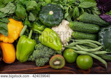 Assorted Of Fresh Vegetables. Colorful Summer Vegetable Frame. Variety Of Raw Green Vegetables As Fr