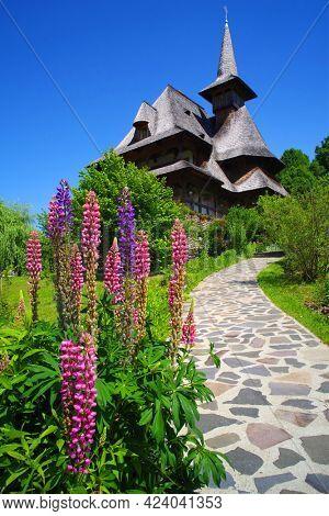 Beautiful summer flowers of Barsana Monastery in Maramures, Romania, Europe